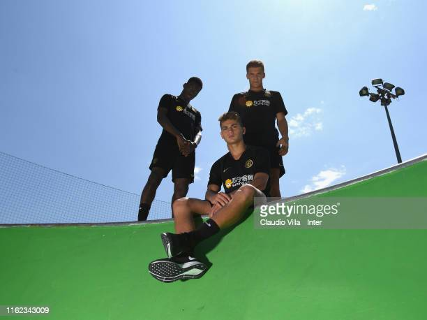 Lucien Agoume Sebastiano Esposito and Filip Stankovic of FC Internazionale pose for a photo before a FC Internazionale training session on July 12...