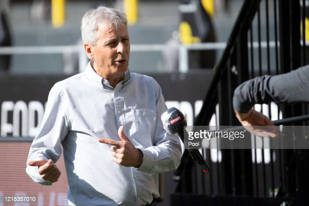 Lucien Favre Head Coach of Borussia Dortmund is interviewed prior to the Bundesliga match between Borussia Dortmund and FC Bayern Muenchen at Signal...