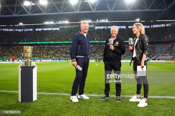 Lucien Favre, Head Coach of Borussia Dortmund speaks to Stefan Effenberg, former professional footballer and Laura Papendick, Sport 1 presenter as he...