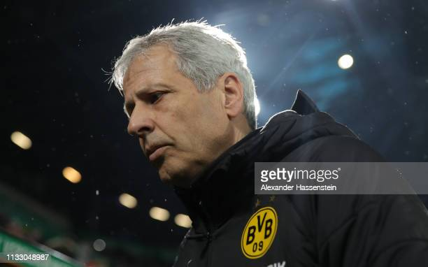 Lucien Favre head coach of Dortmund looks on at the start of the second half during the Bundesliga match between FC Augsburg and Borussia Dortmund at...