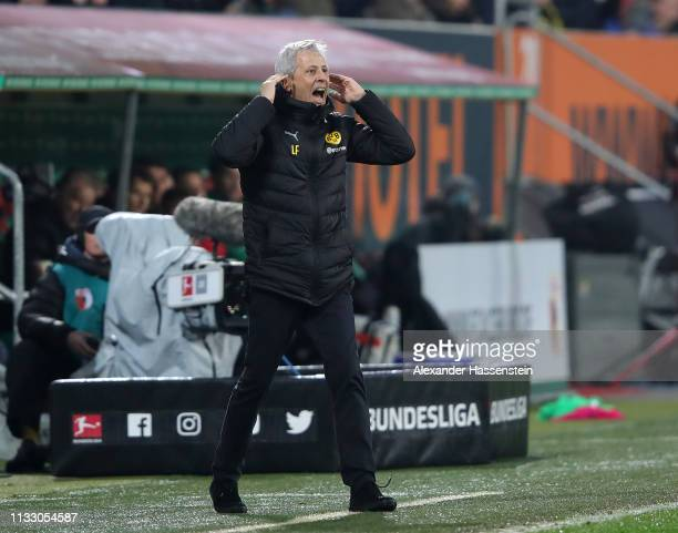 Lucien Favre head coach of Dortmund reacts after the Dortmund goal during the Bundesliga match between FC Augsburg and Borussia Dortmund at WWKArena...