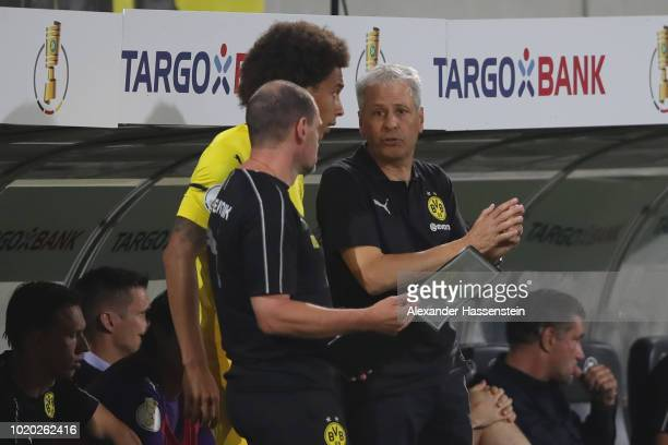 Lucien Favre head coach of Dortmund talsk to his player Axel Witsel during the DFB Cup first round match between SpVgg Greuther Fuerth and BVB...