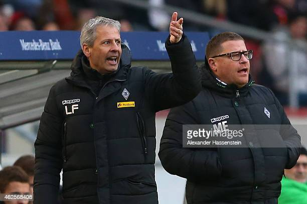 Lucien Favre head coach of Gladbach reacts with Gladbach`s manager Max Eberl during the Bundesliga match between VfB Stuttgart and Borussia...