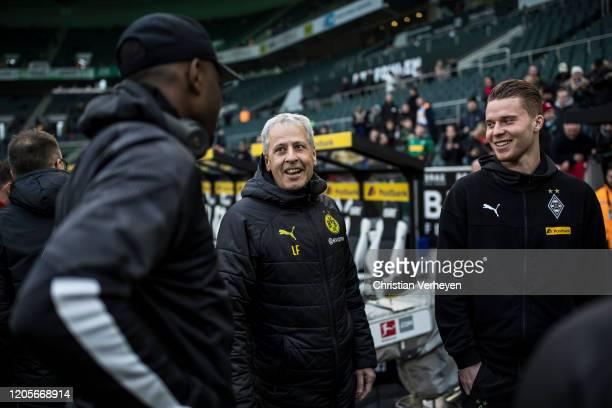 Lucien Favre headcoach of Borussia Dortmund is seen with Nico Elvediand Denis Zakaria of Borussia Moenchengladbach before the Bundesliga match...