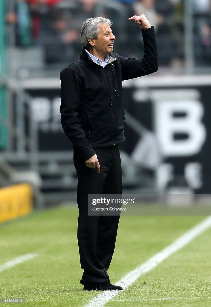 Lucien Favre of Moenchengladbach gives instructions during the Bundesliga match between Borussia Moenchengladbach and Bayern Muenchen at Borussia Park Stadium on May 18, 2013 in Moenchengladbach, Germany.
