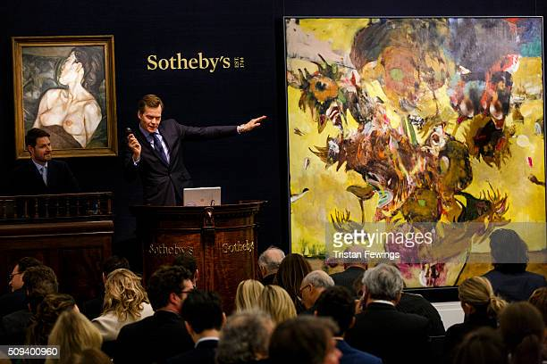 Lucien Freud's Pregnant Girl 196061 and Adrian Ghenie's Sunflowers in 1937 2014 are sold at the Contemporary Art Evening Sale at Sotheby's on...
