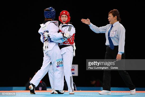 Lucija Zaninovic of Croatiai vs Maeiva Coutant of France compete in the Women's 49kg class Taekwondo 4 December 2011