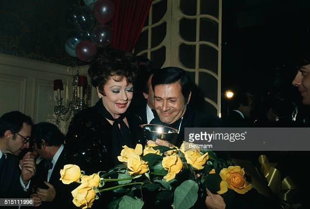 Lucille Ball accepts 1974 After Dark Ruby Award as Entertainer of The Year from Jerry Herman Composer of Mame William Como watches Como is editor of...