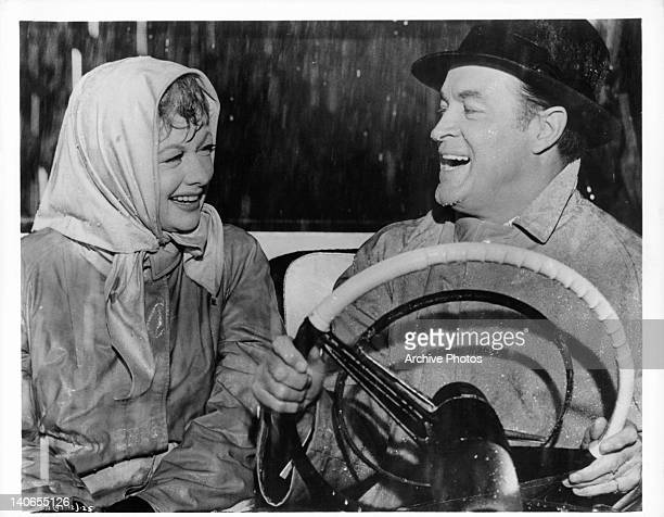 Lucille Ball and Bob Hope soaked and laughing in a scene from the film 'The Facts Of Life' 1960