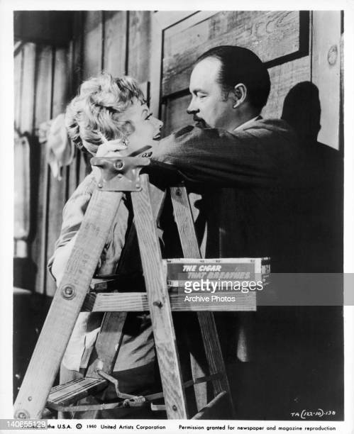 Lucille Ball and Bob Hope up close next to ladder in a scene from the film 'The Facts Of Life' 1960