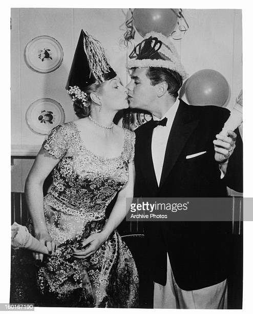 Lucille Ball and Desi Arnaz kissing in publicity portrait for the television series 'I Love Lucy' Circa 1955