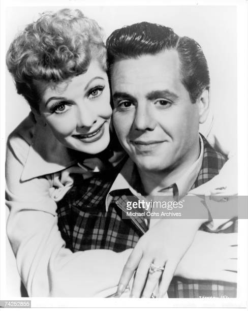 Lucille Ball and Desi Arnaz pose for a portrait to promote their movie 'Forever Darling' in 1956 in Los Angeles California
