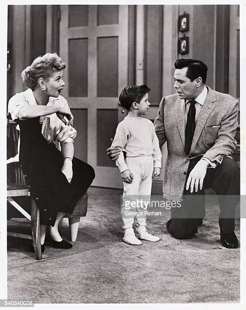 Lucille Ball and Desi Arnaz with their son in a scene from their hit TV series I Love Lucy