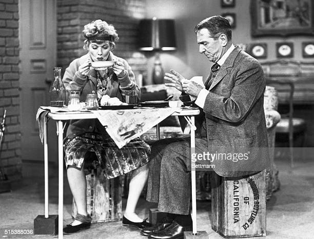 Lucille Ball and Edward Everett Horton sitting at a card table; scene from TV show I Love Lucy. Undated television still.