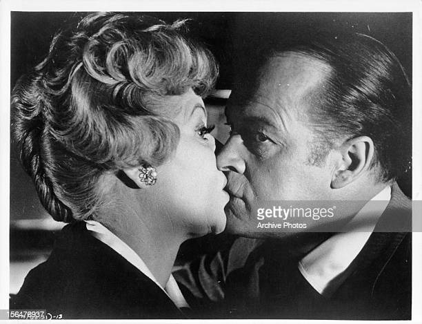 Lucille Ball is kissed by Bob Hope in a scene from the film 'The Facts Of Life' 1960