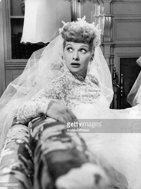 Lucille Ball sitting in bridal dress in a scene from the film 'The Long Long Trailer' 1953
