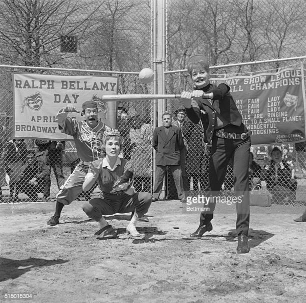 Lucille Ball takes her cut at the plate during the opening game of the Broadway baseball league in Central Park April 20th Catching crown and all is...