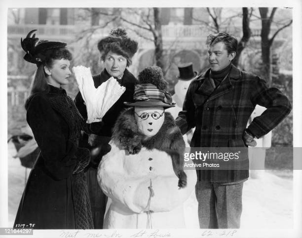 Lucille Bremer Marjorie Main and unidentified actor with snow man in a scene from the film 'Meet Me In St Louis' 1944