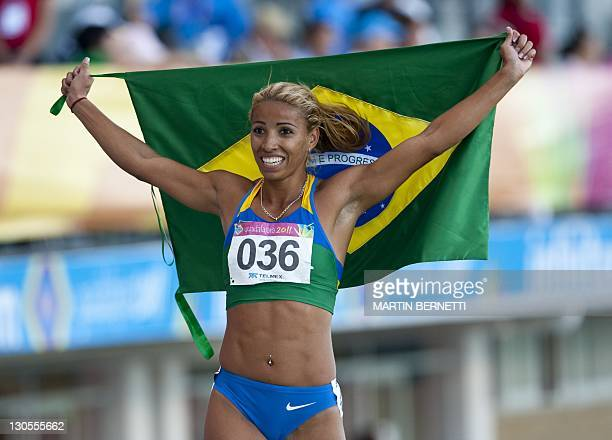 Lucimara Da Silva of Brazil celebrates her Gold medal for the Heptathlon competition during the 2011 XVI Pan American Games in Guadalajara Mexico on...