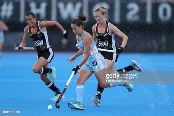 Lucina von der Heyde of Argentina battles with Franzisca Hauke of Germany and Selin Oruz of Germany during the Pool C game between Germany and...