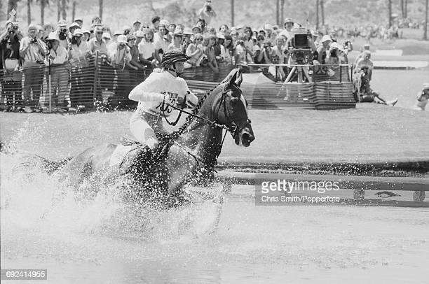 Lucinda Green of Great Britain rides her horse Regal Realm through water in the Cross Country discipline of the Three Day Team Eventing competition...