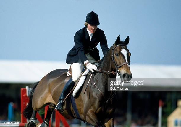 Lucinda Green of Great Britain riding her horse Regal Realm in the showjumping element during the Badminton Horse Trials circa May 1982