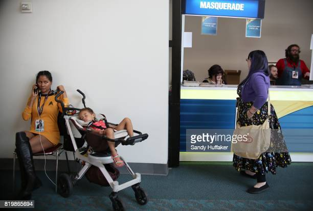 Lucinda Jones dressed as a Star Trek charactor sits with he son at Comic Con International on July 20 2017 in San Diego California Comic Con...