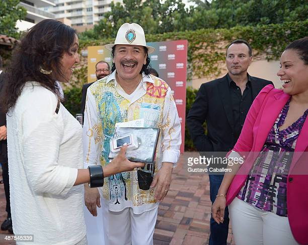 Lucinda Martinez Carlos Santana and Jessica Vargas attend a fireside chat with Carlos Santana during a special screening of Santana de Corazon hosted...