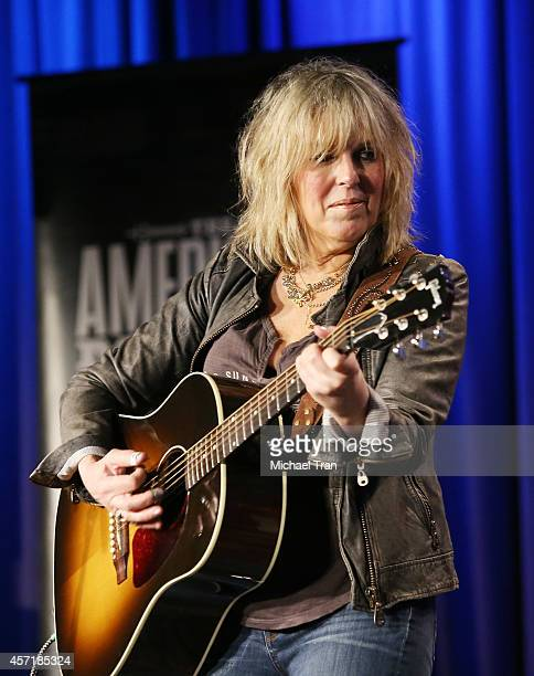 Lucinda Williams performs onstage during the GRAMMY Museum presents The Drop Lucinda Williams at The GRAMMY Museum on October 13 2014 in Los Angeles...