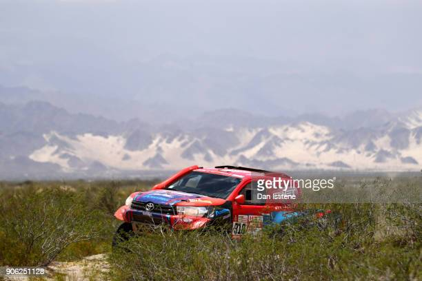Lucio Alvarez of Argentina and Overdrive Toyota drives with codriver Robert Howie of South Africa in the Toyota Hilux in the Classe T11 4x4 Essence...