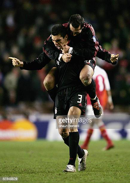 Lucio and Hasan Salihamidzic of Munich celebrate going through to the next round at the end UEFA Champions League First Knockout Round Second Leg...
