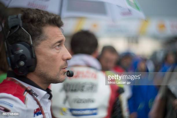 Lucio Cecchinello of Italy and LCR Honda MotoGP looks on on the grid during the MotoGP race during the MotoGP Of Malaysia Race at Sepang Circuit on...
