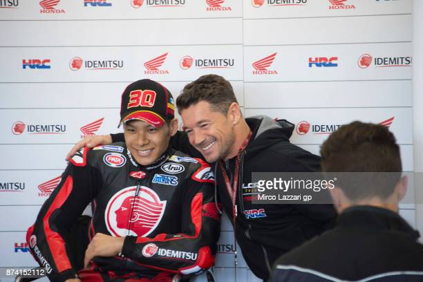 Lucio Cecchinello of Italy and LCR Honda MotoGP poses in box with Takaaki Nakagami of Japan and LCR Honda Idemitsu during the MotoGP Tests In...