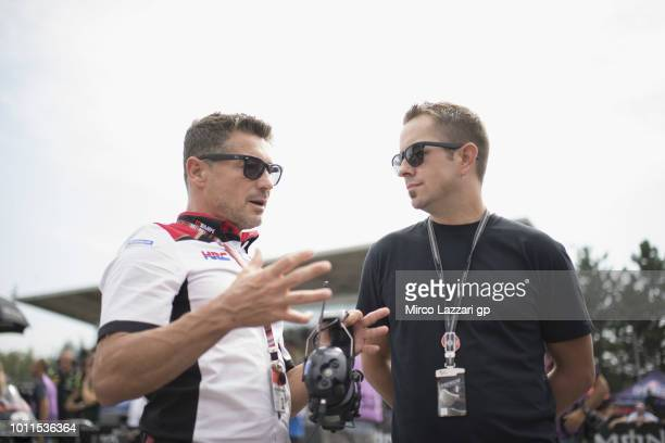 Lucio Cecchinello of Italy and LCR Honda MotoGP speaks with Tommy Lee Hayden of USA on the grid during the MotoGP Race during the MotoGp of Czech...