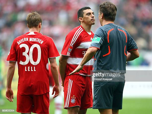 Lucio of Bayern and referee Thorsten Kinhoefer argue during the Bundesliga match between VfL Wolfsburg and FC Bayern Munich at the Volkswagen Arena...
