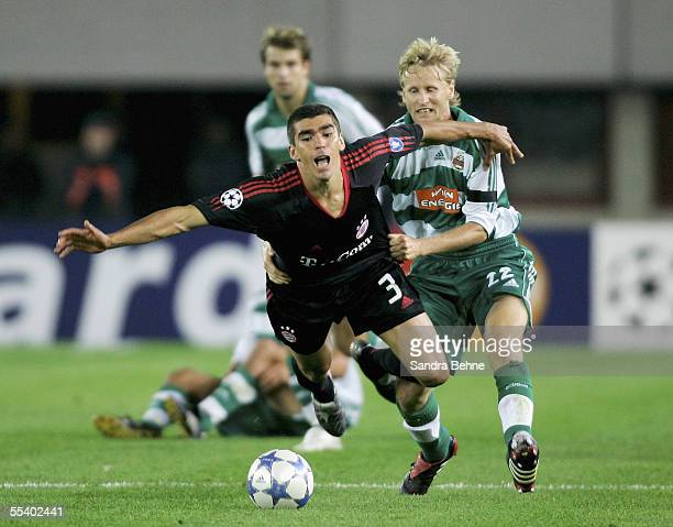 Lucio of Bayern Munich challenges Radek Bejbl of Rapid Vienna during the UEFA Champions League preliminary round group A match between Rapid Vienna...