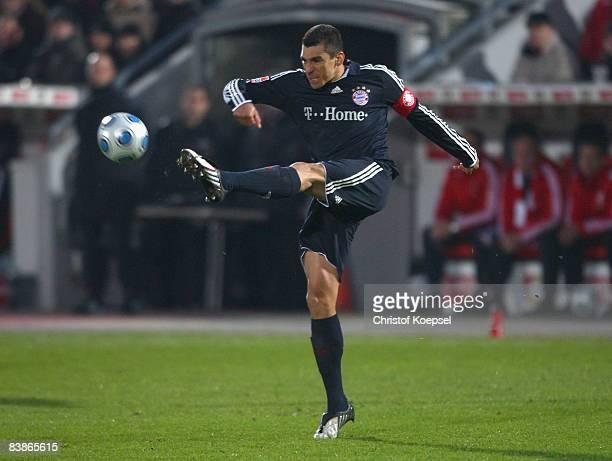 Lucio of Bayern shoots the ball during the Bundesliga match between Bayer 04 Leverkusen and Bayern Muenchen at the BayArena on November 29 2008 in...