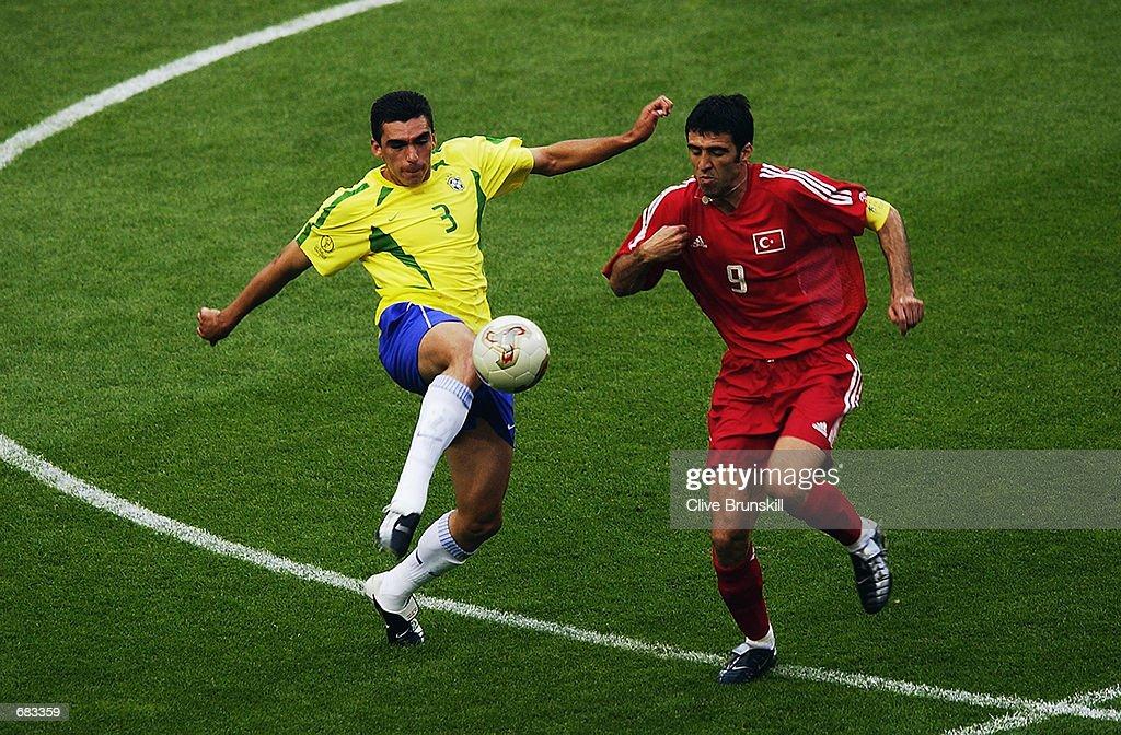 Lucio of Brazil and Hakan Sukur Captain of Turkey : News Photo