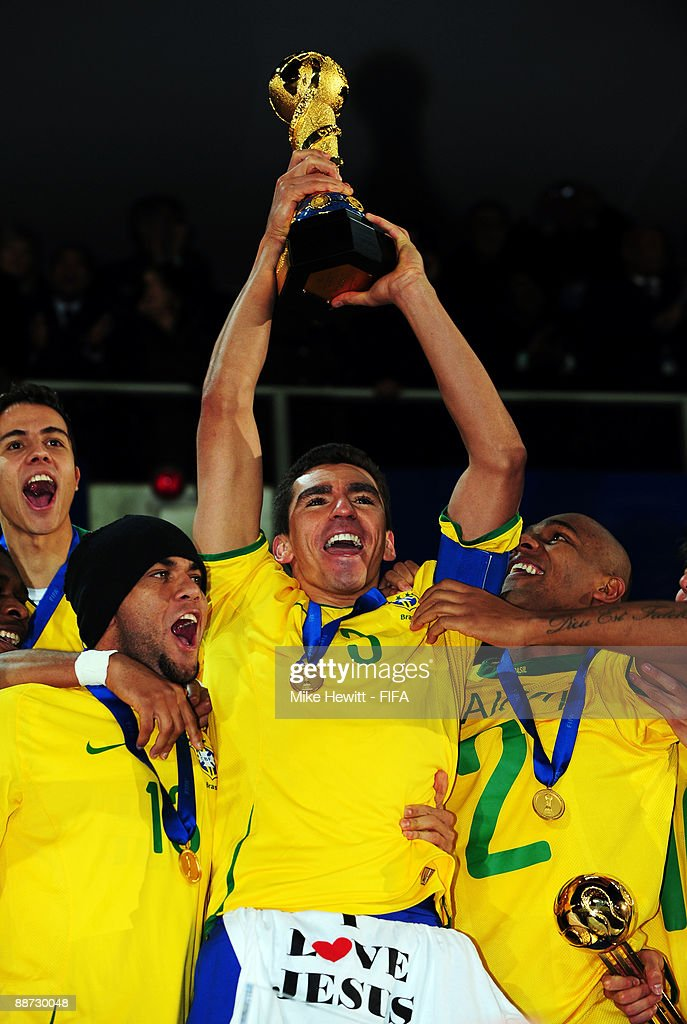 Lucio of Brazil lifts the trophy following his team's victory at the end of the FIFA Confederations Cup Final between USA and Brazil at the Ellis Park Stadium on June 28, 2009 in Johannesburg, South Africa.