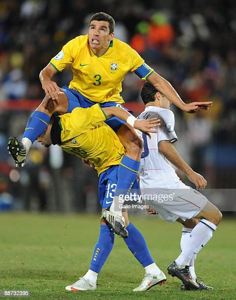 Lucio of Brazil on top of Daniel Alves compete during the 2009 Confederations Cup final match between Brazil and USA from Ellis Park on June 28 2009...