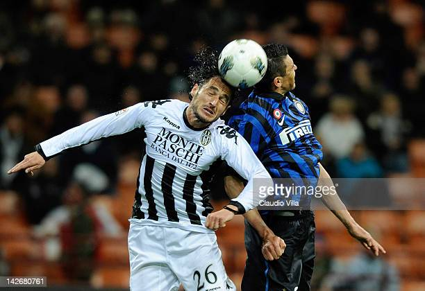 Lucio of FC Inter Milan and Emanuele Pesoli of AC Siena compete for the ball during the Serie A match between FC Internazionale Milano and AC Siena...