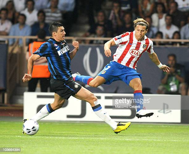 Lucio of FC Inter Milan battles for the ball against Diego Forlan of Atletico de Madrid during the UEFA Super Cup between FC Inter Milan and Atletico...