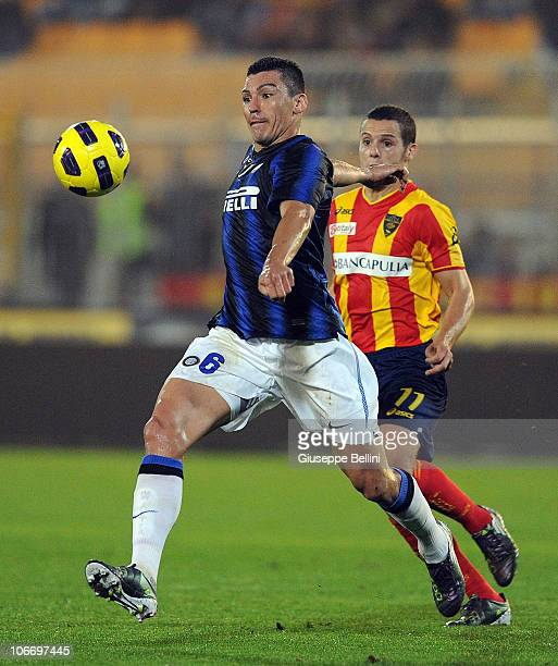 Lucio of Inter clears the ball before Djamel Mesbah of Lecce can make a challenge during the Serie A match between Lecce and Inter Milan at Stadio...