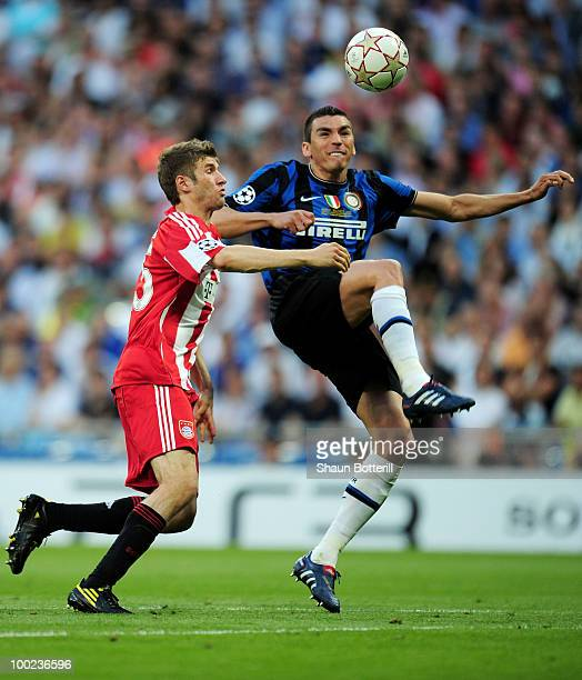 Lucio of Inter Milan is challenged by Thomas Mueller of Bayern Muenchen during the UEFA Champions League Final match between FC Bayern Muenchen and...
