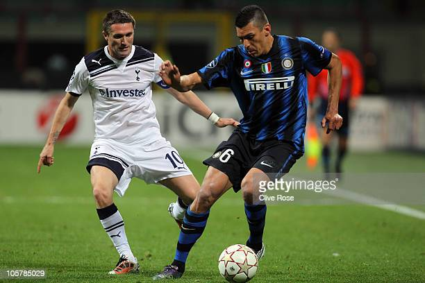 Lucio of Internazionale Milano controls the ball from Robbie Keane of Tottenham Hotspur during the UEFA Champions League Group A match between FC...