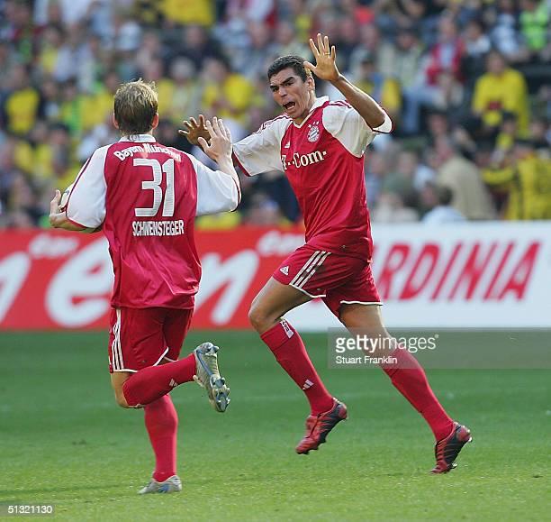 Lucio of Munich celebrates scoring the first goal against Dortmund with Bastien Schweinsteiger during The Bundesliga match between Borussia Dortmund...