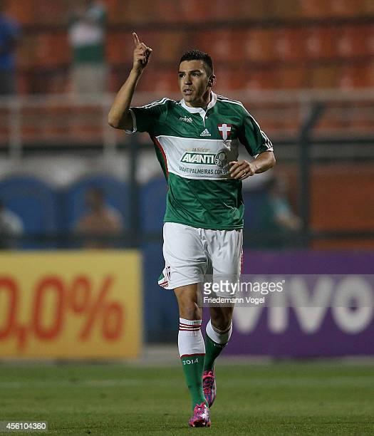 Lucio of Palmeiras celebrates scoring the first goal during the match between Palmeiras and Vitoria for the Brazilian Series A 2014 at Estadio do...