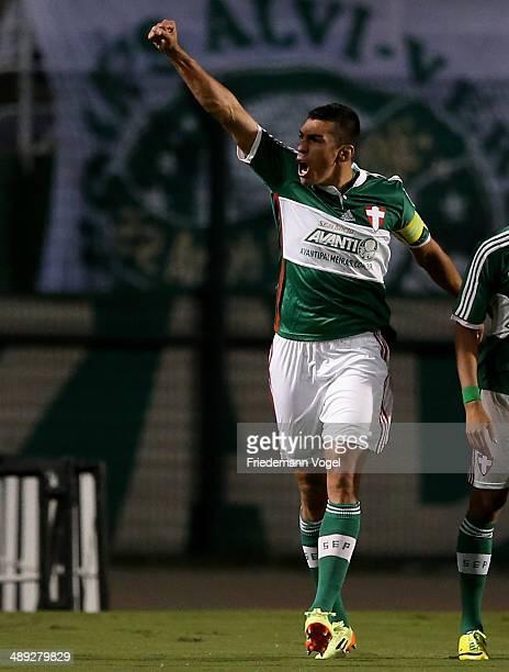 Lucio of Palmeiras celebrates scoring the first goal during the match between Palmeiras and Goias for the Brazilian Series A 2014 at Estadio do...
