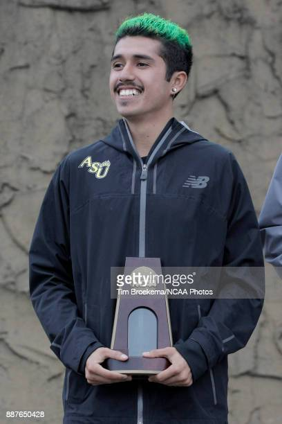Lucio Ramirez of Adams State University is photographed with his 13th place trophy during the Division II Men's Cross Country Championship held at...