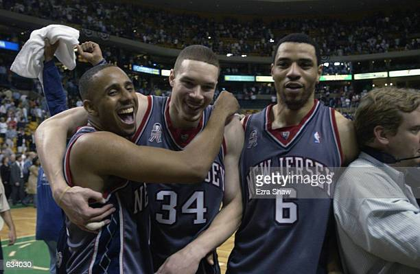 Lucious Harris Aaron Williams and Kenyon Martin of the New Jersey Nets celebrate after they defeated the Boston Celtic in Game 6 of the Eastern...